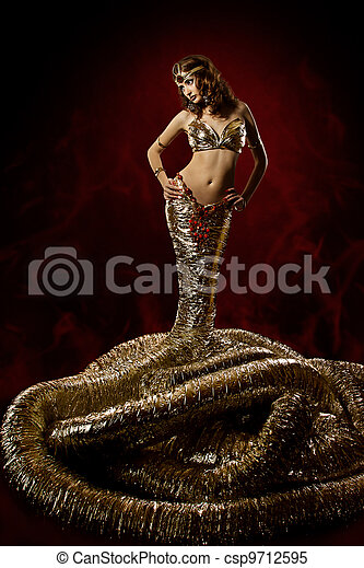 Beautiful woman in fantasy dress. Snake fashion dress stylish. Abstract background. Artwork - csp9712595