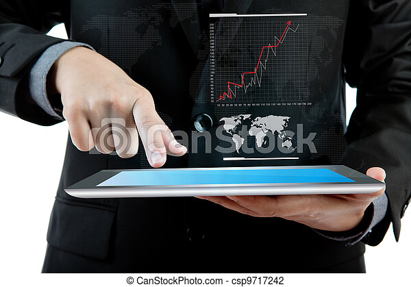 Business man holding the modern digital tablet pc with success growth chart - csp9717242
