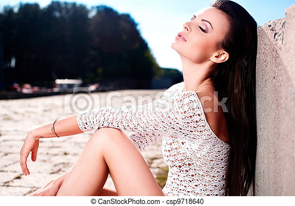 High fashion look.glamour portrait of beautiful sexy brunette female model girl in white lingerie outdoors .blue sky.sitting near sea - csp9718640