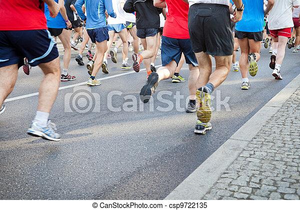 People running in city marathon on street - csp9722135