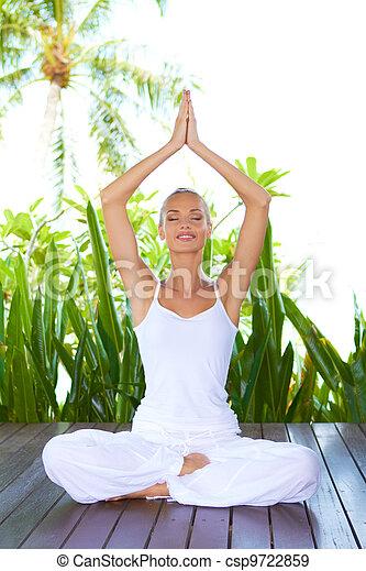 Woman doing yoga breathing exercises - csp9722859