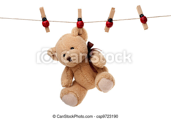Teddy bear hanging on clothesline - csp9723190