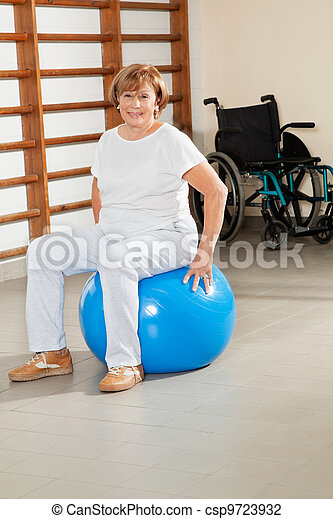 Senior Woman Sitting On Fitness Ball - csp9723932