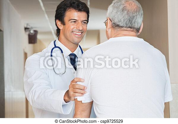 Doctor Assisting Senior Man - csp9725529
