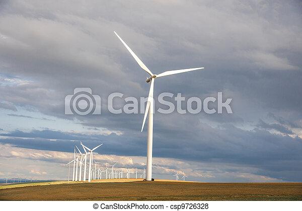 Wind turbines below a stormy sky - csp9726328