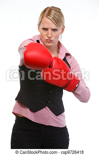 Anger woman employee in boxing gloves punching - csp9726418