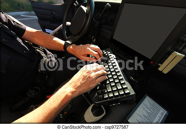 Officer Using in Vehicle Computer for Public Safety - csp9727587