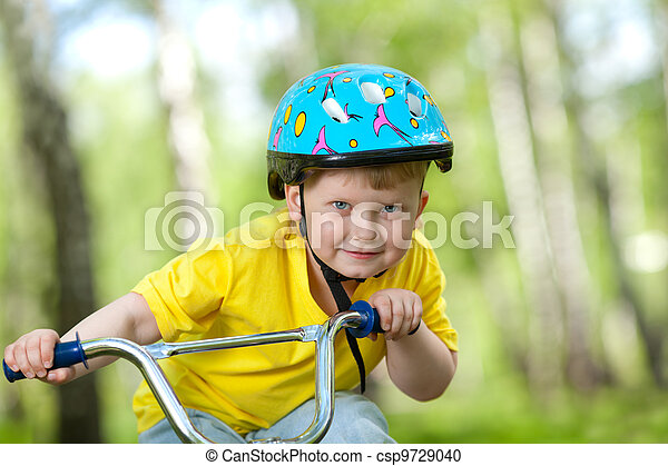 Portrait of a cute child on bicycle - csp9729040
