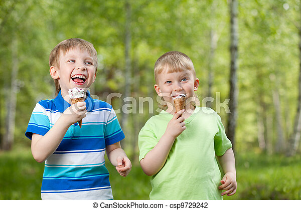young kids eating a tasty ice cream outdoor - csp9729242