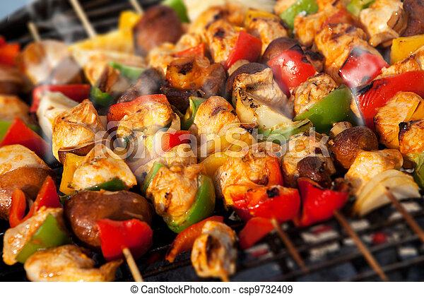 BBQ barbecuing skewers kebab - csp9732409