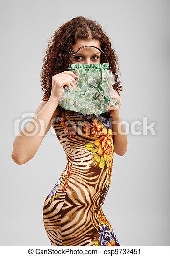 Merry girl with a handbag. - csp9732451