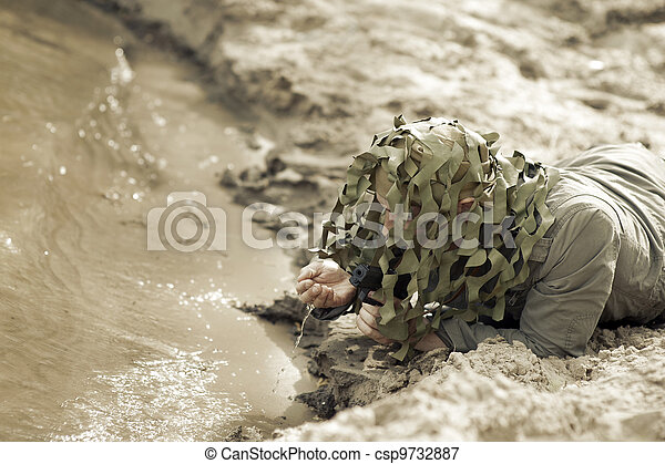 Military Camouflaged man - csp9732887