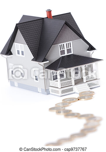 Coins in front of household architectural model, isolated - csp9737767