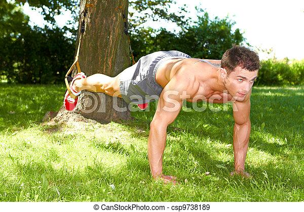 Fitness man doing push ups - csp9738189