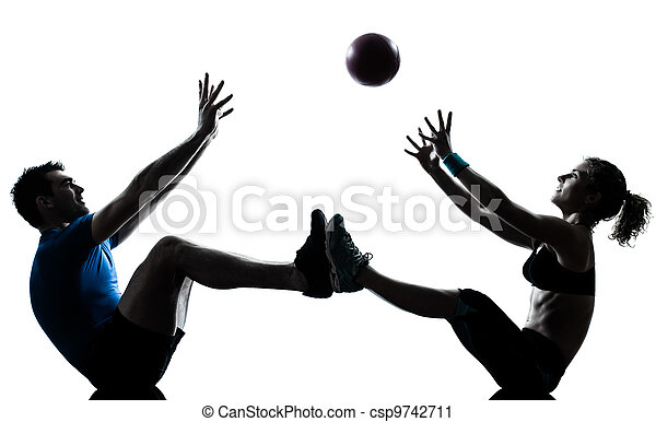 man woman exercising workout tossing fitness ball - csp9742711