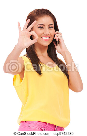 casual woman with phone and ok gesture - csp9742839
