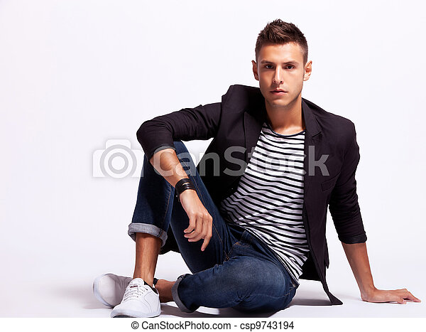 young fashion man sitting relaxed - csp9743194