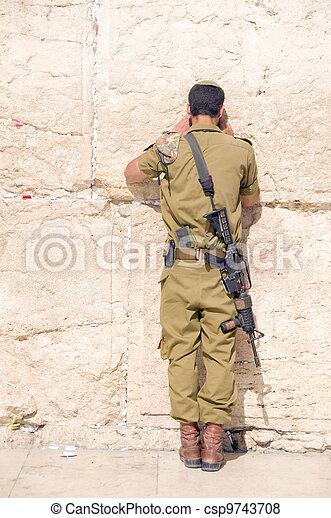 Israel military army man praying The Western Wailing Wall Jerusalem Palestine Israel - csp9743708