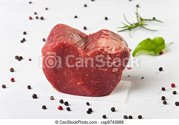 raw piece of beef loin on wood  - csp9743988