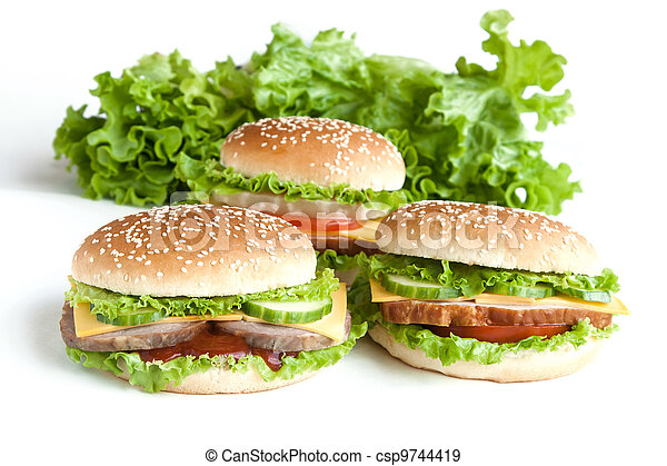 three burger with meat and vegetables - csp9744419