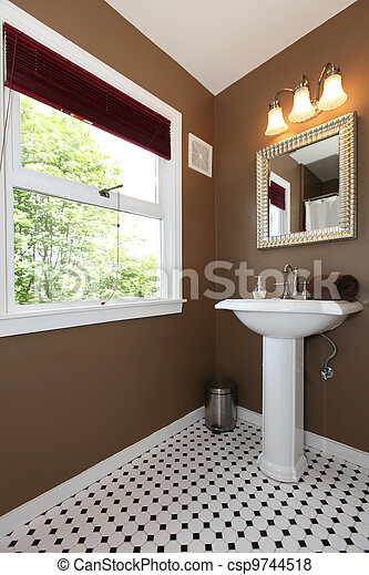 Brown small bathroom with antique sink and tiles. - csp9744518