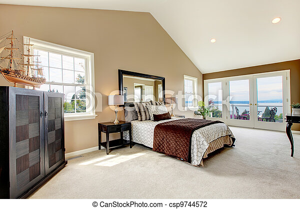 Classic luxury large bedroom with water view and carpet. - csp9744572