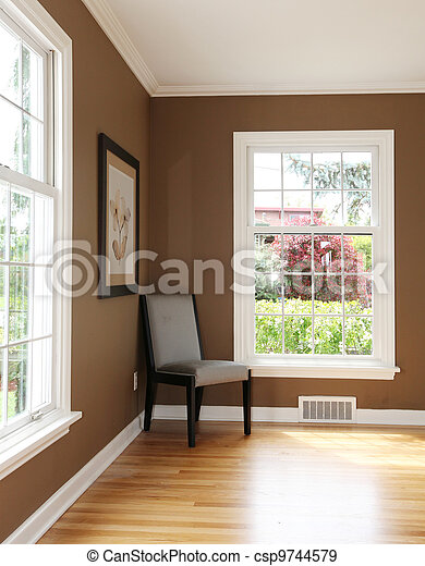 Living room corner with chair and two windows. - csp9744579