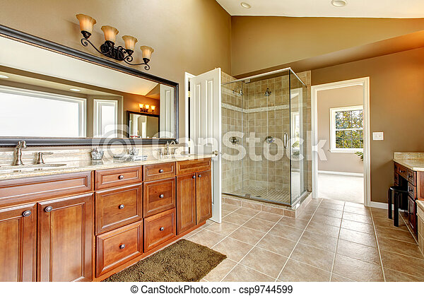 Luxury new large bathroom interior with brown tiles. - csp9744599