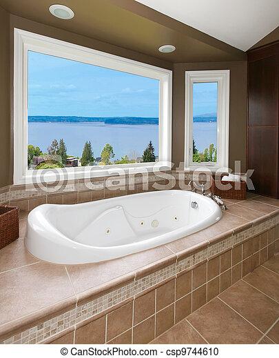 Stock fotografie van bruine badkamer nieuw kuip water aanzicht beige csp9744610 zoek - Bruine en beige badkamer ...