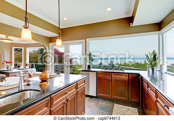 Modern luxury kitchen with water view and sink. - csp9744613