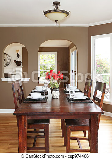 Dining room with brown walls and wood table in the luxury home.