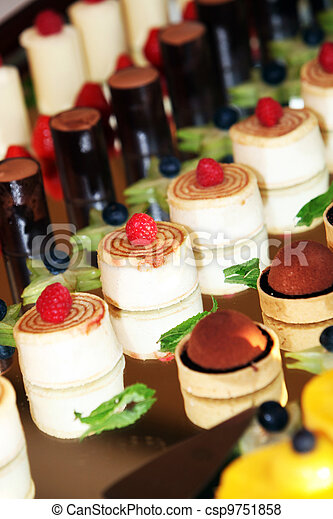 Individual desserts on mirrored surface - csp9751858