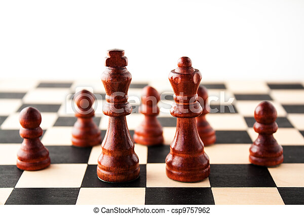 King and Queen in front of their royal subjects the pawns. - csp9757962
