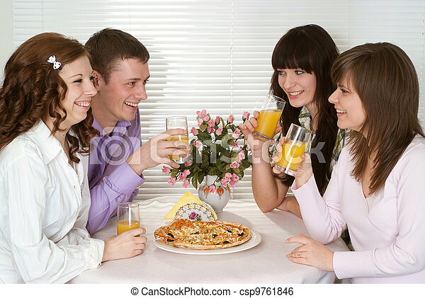 Pleasant Caucasian group of four people with pizza and juice sitting in a cafe - csp9761846