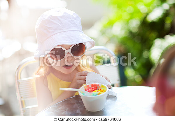 Cute girl eating ice cream - csp9764006