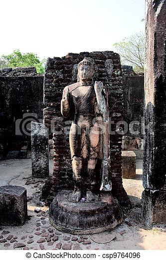Ancient Buddha statue  in Polonnaruwa - vatadage temple, UNESCO World Heritage Site in Sri Lanka  - csp9764096