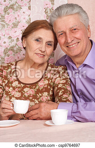 A beautiful pair of elderly people sitting together