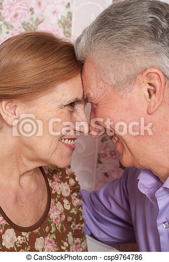 A beautiful pair of older people sitting together
