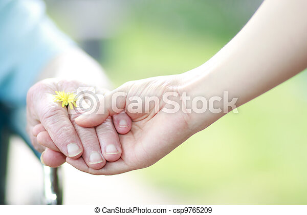 Young and senior women holding hands - csp9765209