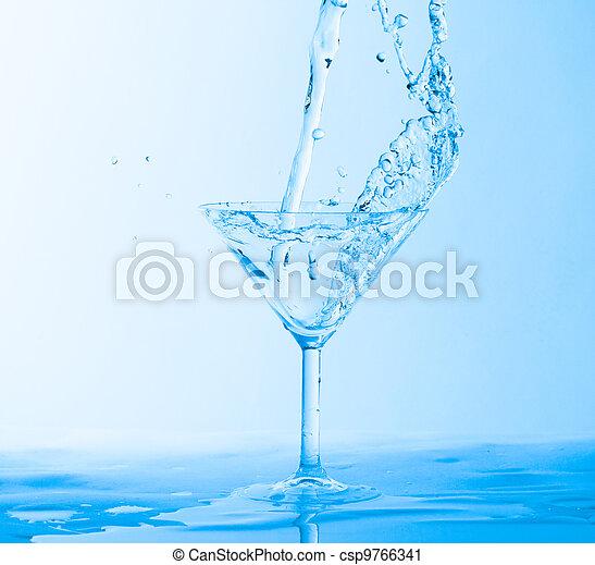 Water Splashing in a Wineglass - csp9766341