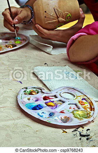 Children painting pottery 7