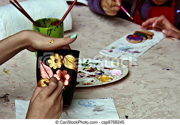 Children painting pottery 9