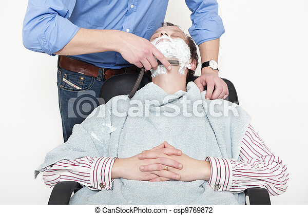 Man Being Shaved With Cut Throat Razor - csp9769872