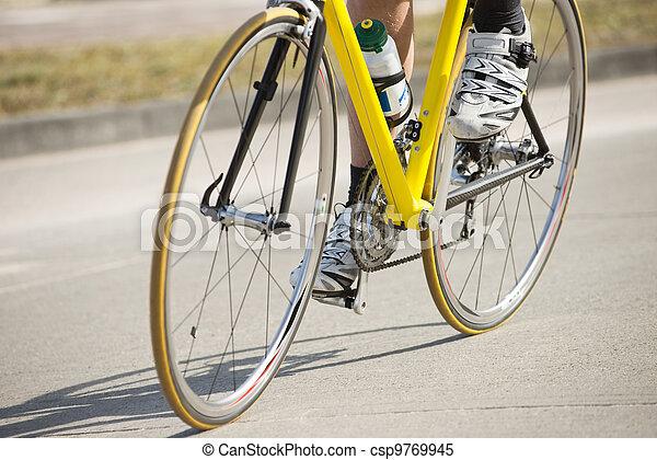 Male Athlete Riding Bicycle - csp9769945