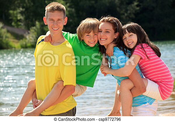 Happy children by lake - csp9772796