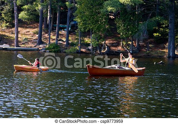 two brothers out paddeling at the cottage - csp9773959