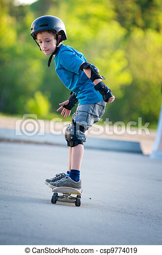 young boy learning how to skateboard - csp9774019
