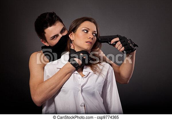 Man take a beautiful woman as a hostage - csp9774365