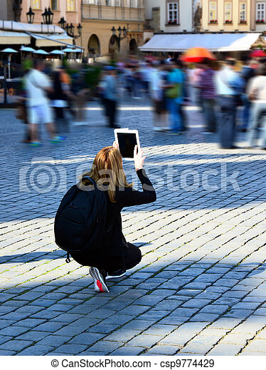 White Ipad, woman in black taking photos - csp9774429