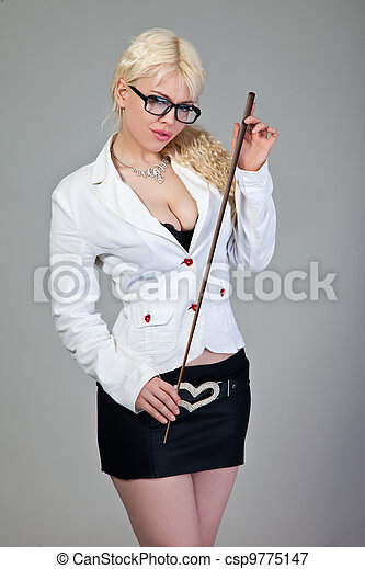 Sexy teacher is holding a  pointer on grey - csp9775147